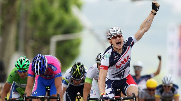 Andre Greipel of Germany and Lotto-Belisol Team celebrates winning stage four of the 2012 Tour de France from Abbeville ...
