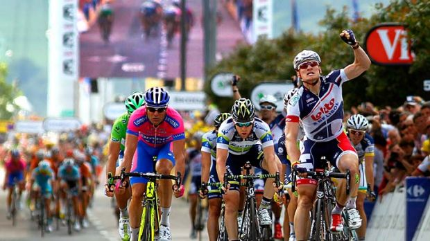 Andre Greipel (right) of Germany riding for Lotto-Belisol celebrates as he wins stage four of the 2012 Tour ahead of ...