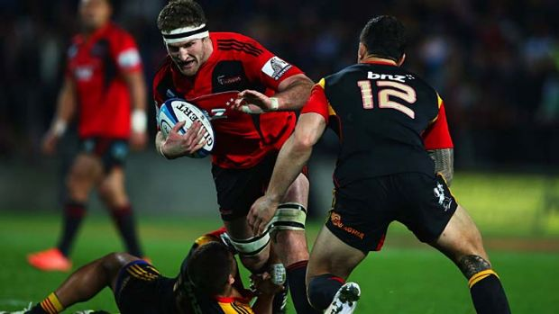 Raw power ... Kieran Read takes on the Chiefs' defence.