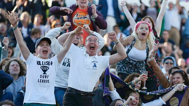 Fans celebrate Andy Murray's win against Jo-Wilfried Tsonga of France in the semi-final.