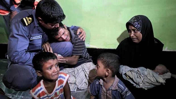 Outcasts ... a man weeps after his arrest in Bangladesh.
