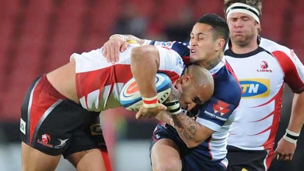 Richard Kingi of the Rebels tackles Waylon Murray of the Lions.