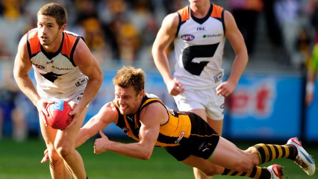 Sam Mitchell desperately lunges after Giant Callan Ward.