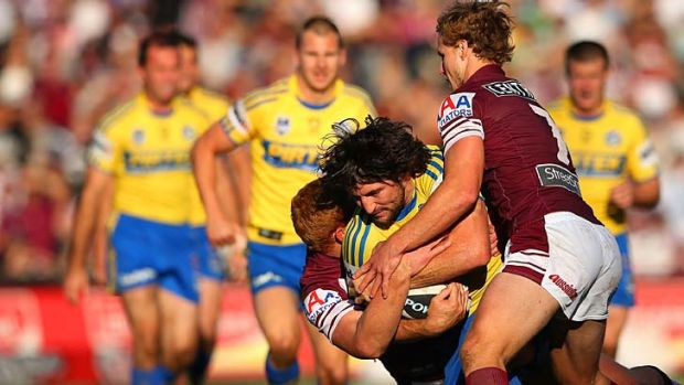 Nathan Hindmarsh of the Eels is tackled.