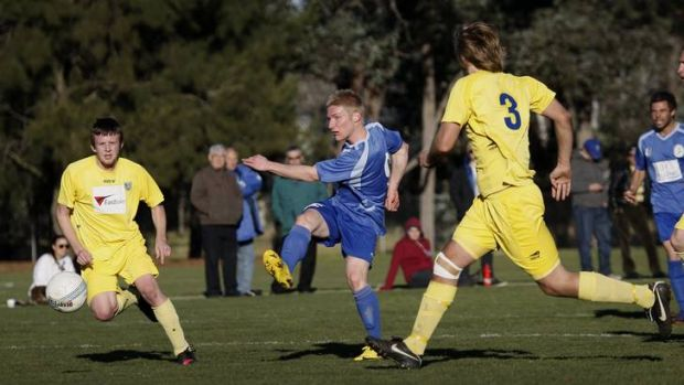 Canberra Olympic's Oliver Weiderkehr takes a shot at goal.