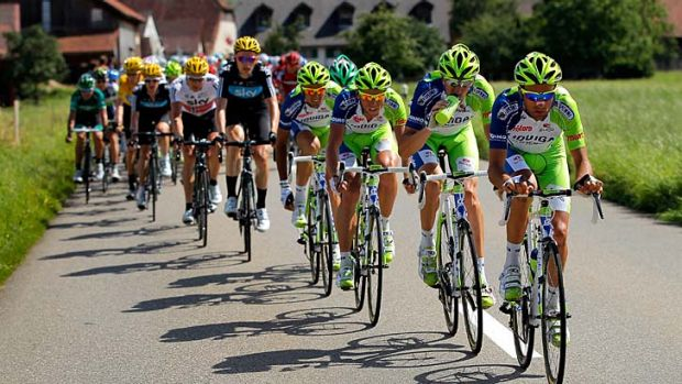 The  Liquigas-Cannondale train ramps up the pace at the front of the peloton.