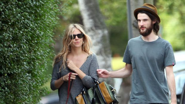 Sienna Miller and Tom Sturridge out and about earlier this year.
