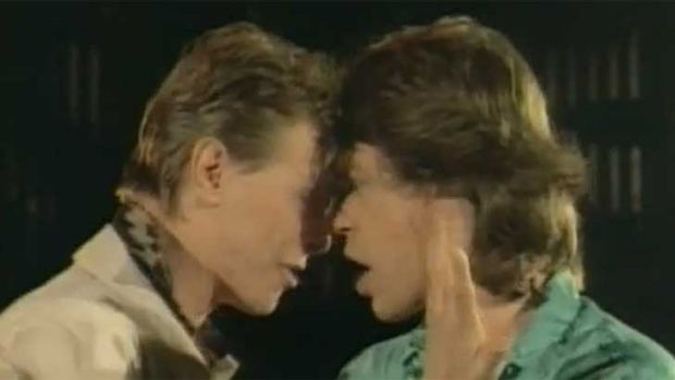 David Bowie and Mick Jagger get up close and personal in their 1985 video for <i>Dancing in the Street</i>.