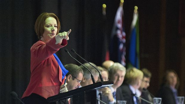 Prime Minister Julia Gillard calls for questions from a person attending a community cabinet meeting at Redbank Plains ...
