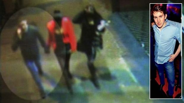 The last image ...  A CCTV image of Thomas Kelly talking on his phone as he holds the hand of his new girlfriend, ...