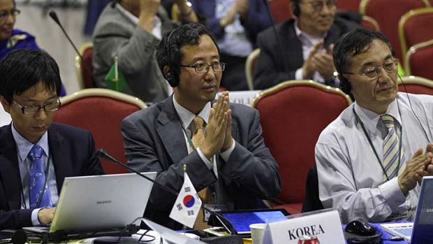 Representatives from South Korea attend a meeting on the last day of the 64th annual International Whaling Commission ...
