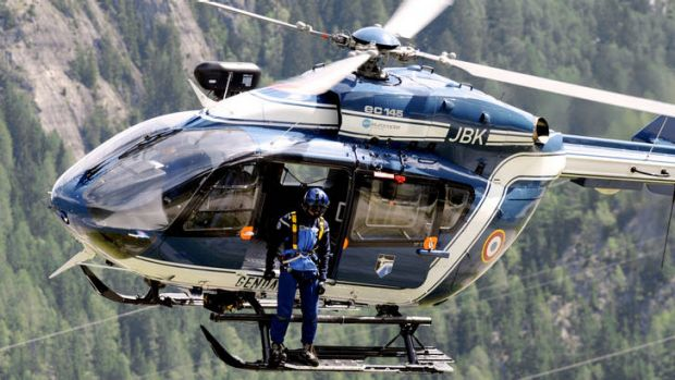 Nine dead ... a French Gendarmerie helicopter searches for victims of the avalanche.