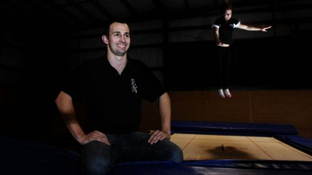 Jack Ratz, coach of the Canberra Trampoline and Sports Club, with Djakirri Crafter, 14, of Yass practising in the ...