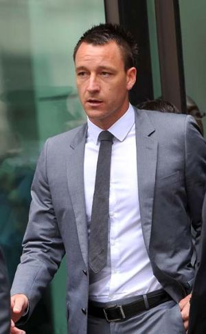 John Terry leaves court after he was found not guilty of racial abuse.