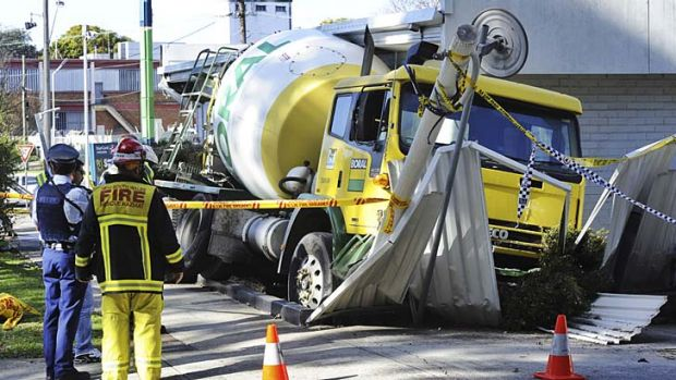 A cement truck causes a swathe of destruction at a petrol station on the Pacific Highway at Chatswood today.