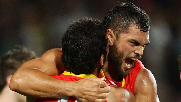 Karmichael Hunt celebrates his match-winning goal after the final siren during the Gold Coast Suns' match against ...