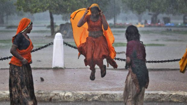 A moment of joy for some, as women in New Delhi enjoy the arrival of monsoonal rains.