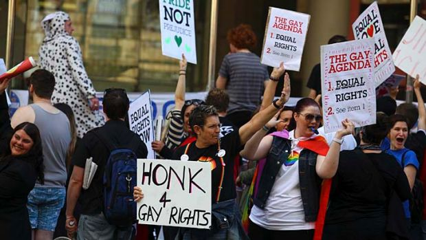 Members of the gay, lesbian, bisexual, transgender and intergendered community protest outside the LNP state conference.