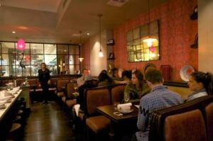 Red Lantern's soft, glowing dining room echoing Veitnam's French-colonial past.