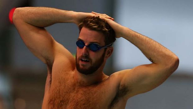 Hair today, gone for London … a bearded James Magnussen limbers up at training in Manchester. The 100m gold medal ...