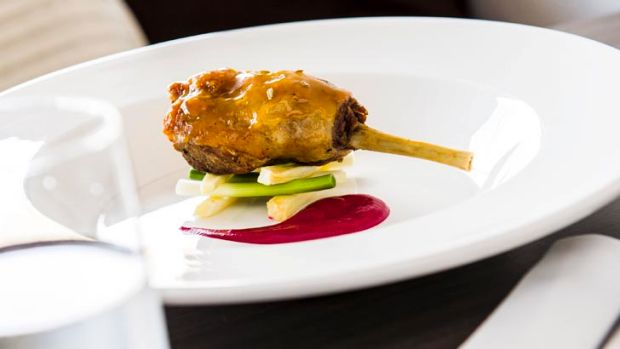 Orange and fennel-glazed confit duck maryland with pencil leek, parsnip and beetroot.