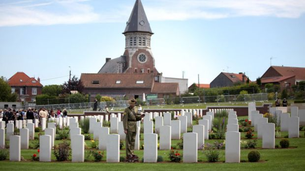 A lone Australian soldier inspects the cemetery at Fromelles, where the bloody military battle began 96 years ago today. ...
