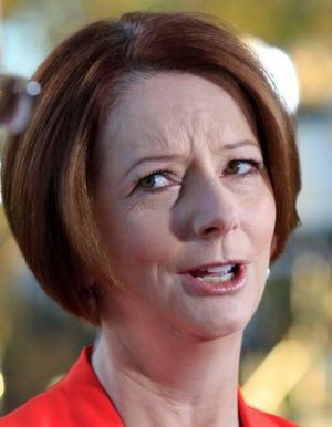Julia Gillard says Tony Abbott has hit a 'new low in negativity'.