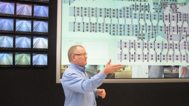 Ray Wilson, Brisconnections' chief executive officer, briefs the media in the Airport Link control room.