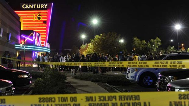 Tragedy ... People gather outside the Century 16 movie theatre in Aurora, Colorado.