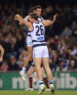 Tom Hawkins and Steven Motlop celebrate.