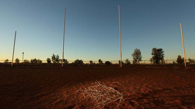 Yuendumu's red sand football oval lies unused.
