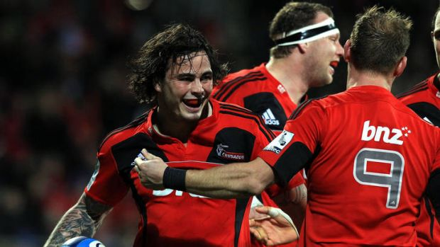 Zac Guildford of the Crusaders celebrates his try with teammate Andy Ellis.