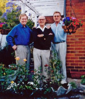 Michael Kirby with his father Don and partner Johan van Vloten at their Sydney house in 2002.
