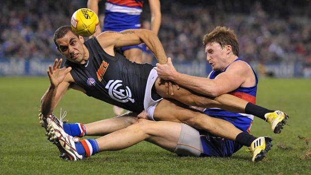 In tight: Chris Yarran shows an example of the Blues' spirit in last night's close contest against the Western Bulldogs.