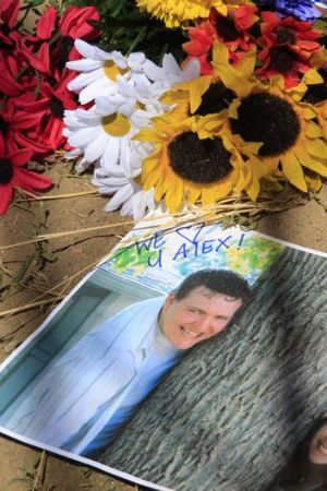 Victim ... flowers surround a photograph of Alex Sullivan who was celebrating his 27th birthday.