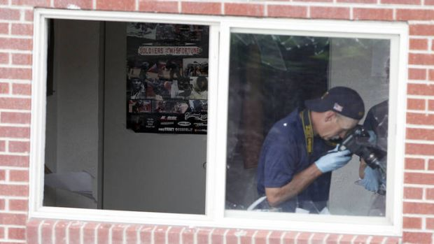 FBI agents in the apartment of alleged gunman James Holmes.