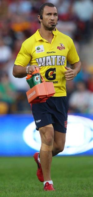 The water boy ... Quade Cooper acted as a water boy for the Reds on Saturday.