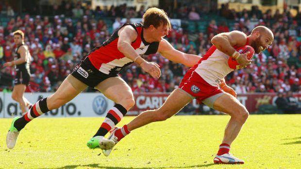 Swan Jarrad McVeigh shrugs off Saint Brendan Goddard, a shapshot that sums up yesterday's clash.