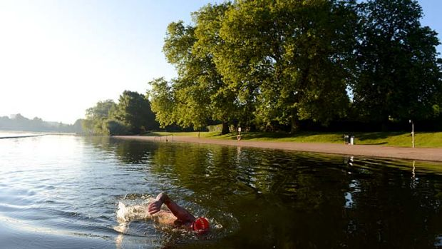 A swimmer in the Serpentine Lake at Hyde Park in London.