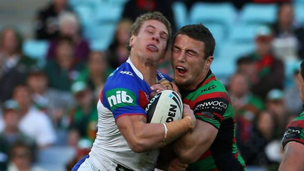 Impact ... Knights Kyle O'Donell gets knocked out by a shoulder charge from Souths Sam Burgess.