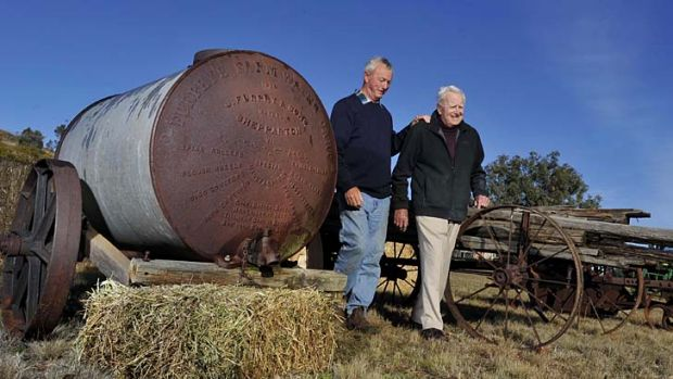 ''It was used when my grandfather and his brother came here'' … Malcolm and Russell Heath with the Furphy water ...