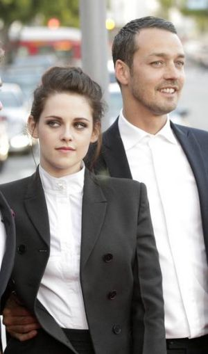 Kristen Stewart poses with director Rupert Sanders, with whom she has admitted having a fling.
