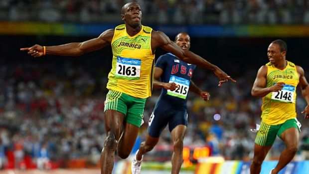 Aiming for victory ... Usain Bolt crosses the line in the mens 100m final at the 2008 Beijing Olympics.