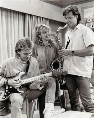 Singing is only a good start ... Kylie Minogue, Jason Donovan and Guy Pearce on the set of Neighbours.
