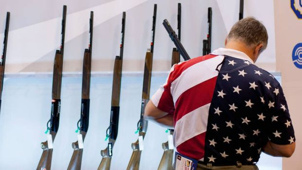 A man examines shotguns at a National Rifle Association exhibition in Missouri earlier this year.
