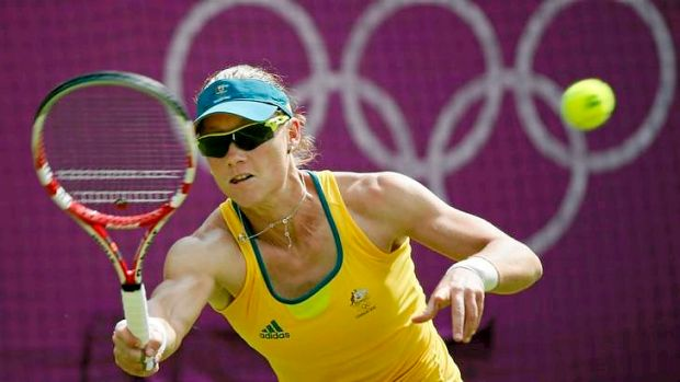 Samantha Stosur hits a forehand during her first round loss in the Olympic tennis singles at Wimbledon.