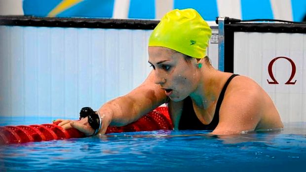 An exhausted Stephanie Rice in her lane after missing a medal in the women's 400m individual medley.