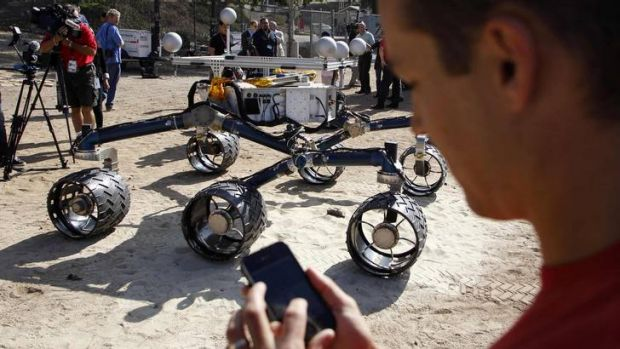 Matt Heverly uses an iPhone app to control the rover.
