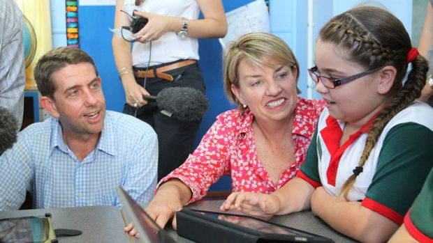 Then Minister for Education Cameron Dick and Premier Anna Bligh talk with student Brydie Milburn during a visit to Eimeo ...