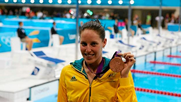 Bronze ... Australia's Alicia Coutts shows off her medal after coming third in the 100m butterfly.